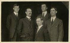 """Faculty members of the Horticulture Department pose for a picture. Written on the back is: """"Members of the Horticulture Department at Michigan Agriculture College in 1910. Left to right. Harry J. Eustace, Professor of Horticulture and Head of Dept. Thomas _____. C.C. Hood, Moleculer(?). C. A. Halleycur (?)Asst. Prof."""" The correct names of the professors are Harry J. Eustace, Thomas Gunson, George William Hood, [unknown], and Charles Parker Halligan. The photo appears to have been taken in…"""