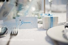 Personalised winter wonderland place cards, choose with or without diamontes. Each card is printed with your guests names on and personalised on the back with the bride and grooms names and wedding date by www.fuschiadesigns.co.uk.