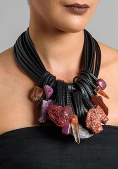 Monies 15 Leather Strands with 18 Stones • Ebony & Leather Closure • One-Of-A-Kind Color: Purple Material: Coral, Fluorite, Mountain Crystal, Ebony; Leather; Made in Denmark