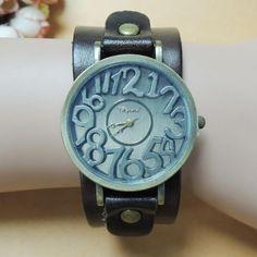 16014 Casual csajoknak nagyon olcsón - széles bőrszíj, feltűnő óra