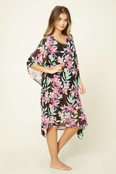 A sheer woven swim cover up with an allover floral print, a self-tie cutout back, a V-neckline, and 3/4 dolman sleeves.