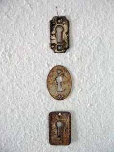 Rusty old keyholes.