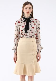 - Ruffle neck with self-tie bowknot