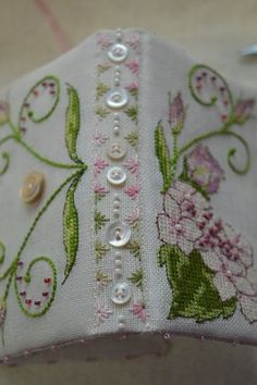 Pretty button and stitching on needlebook spine