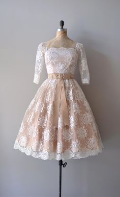 1950s white lace dress with nude under layer. scalloped square neckline, 3/4 length sleeves & velvet bow