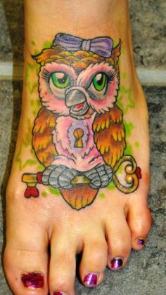 Owl Lock and Key tattoo on top of foot.