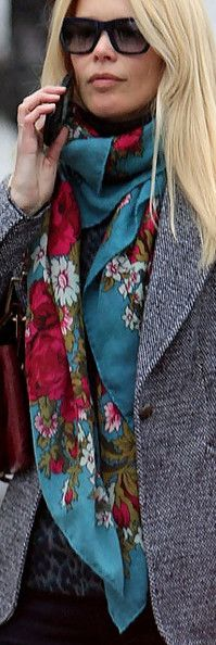 Claudia Schiffer wearing a beautiful floral scarf.
