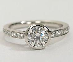 Love Tiffany Bezel settings? Check out the Blue Nile Bezel Set Pave engagement ring setting.