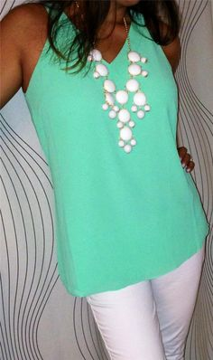 Mint blouse with white necklace is gorgeous!