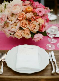 Scalloped-edge plates make this table setting even more dreamy.