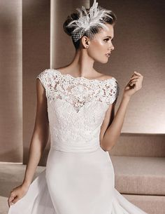 Rene by La Sposa is a classic and elegant wedding dress.  The soft chiffon skirt pairs perfectly with the lace bateau neckline.  www.premierecouture.com