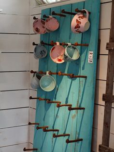 North Peace: Livsnjutarresan: fabulous Pottery...painted fence panel w/railroad spikes as display.