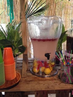 Tiki bar refreshments. Raspberry Lemonade with fresh squeezed lemons and simple syrup and topped with raspberries!