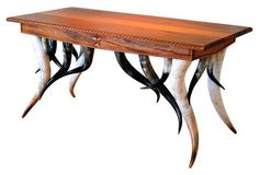 Horn & Mahogany Desk A remarkable three-drawer desk with hand-planed and hand-carved Honduran mahogany top, skirt and drawers; polished Texas longhorn legs and horn gallery. This extraordinary, one-of-a-kind desk was the final work completed by Master American craftsman Milo Marks before his retirement. Signed and dated. As described by Bruce Kapson Gallery