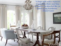 """""""A large table with a regiment of matching chairs marching around it can often feel like an unwelcoming boardroom."""" —Darryl Carter   - Veranda.com"""