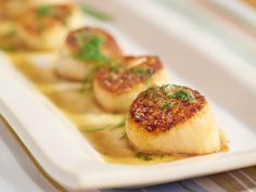 Get Seared Diver Scallops with Caper-Honey Sauce Recipe from Food Network