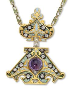 A gem set enamel and gold pendant by René Lalique, of Russian influence, the lower section centred with a circular cabochon amethyst and with circular cut diamonds set to the scrolling enamel ground. Suspended from a conforming hinged upper section emblematic of the onion domed Cathedral form. The reverse pierced with daisies and scrolls. Surmounted by a stylised fleur de lys. Signed René Lalique and with French control marks.