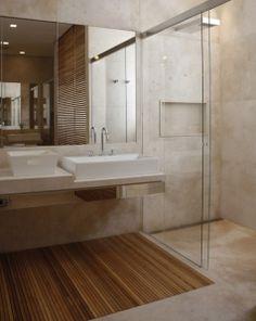 Banheiro com parede e piso de cimento queimado