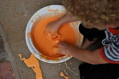 Cornstarch + water = GOOP! (Add a few drops of food colouring for cool colour mixing~let the kids stir it in with a spoon, then they can play using their hands.) I love this stuff! :)