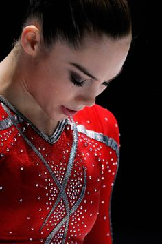 Here's McKayla Maroney in a striking red/silver leotard (the same pattern, in fact, as her teammate Simone's pink one).   41 Of The Best, Most Extravagant Leotards From The 2013 World Gymnastics Championships