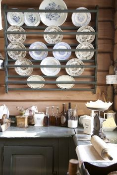 Plate rack in a log cabin...mmmmm