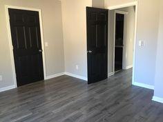 Living room grey floor black doors ideas for 2019 Grey Laminate Flooring, Grey Hardwood Floors, Black Interior Doors, Black Doors, Grey Doors, Living Room Flooring, Bedroom Flooring, Living Room Grey, Grey Walls