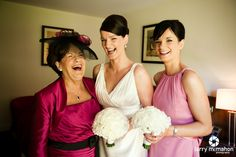 bride and her mum and sister share a giggle