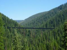 Hiawatha Bike Trail, Montana/Idaho - This popular bike ride follows an abandoned rail-bed 15 miles downhill through tunnels and over trestles to Pearson in Idaho. Ride both directions (2% grade back uphill) or take a shuttle bus back to the top. There is a fee for this ride and also the shuttle and it is not open all year so check the links below for more information. Also make sure you have something warm for the Taft tunnel and a good bike light and a helmet.