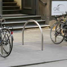 The Cycla Hoop Standard is a hard-wearing and economical solution for safe and secure bicycle parking and features a heavy duty hoop construction. Bike Locker, Best Bike Rack, Cheap Bikes, Bike Parking, Bicycle Wheel, Construction Design, Good And Cheap, Public Spaces, Lockers
