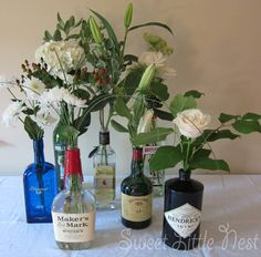Centerpieces made from liquor bottles and simple flowers. Or wine bottles. Or generic bottles. Whatever. The point is these were so easy and they looked great.