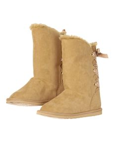 Fashionable boot with fuzzy lining and ribbon lacing in back.