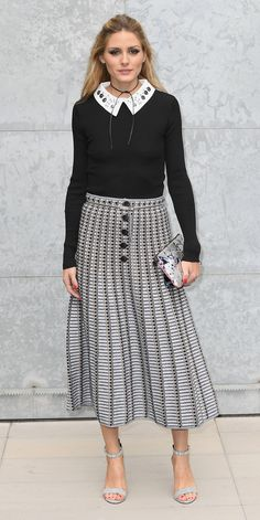 Olivia Palermo continued her parade of Fashion Week front row looks and arrived at the Giorgio Armani spring 2017 show in Milan in a bejeweled-collared knit tucked into a graphic printed midi skirt, accessorizing with a black shoelace choker, a neutral clutch, and pastel ankle-strap sandals.