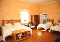 Farmstyle accommodation with beautiful wooden floors and crisp white tones at Wilgewandel Holiday Farm.