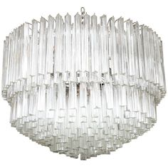 """For Sale on 1stdibs - A unique and magnificent Murano glass chandelier in the style of Camer. 36"""" diameter. Comprised of individually hand blown Murano glass triangular"""