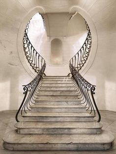 Stairway to Heaven... The ethereal curvature of the lines in this WROUGHT IRON trimmed staircase are further enhanced by symmetry and a single light at the end of the landing (subliminal message perhaps?).