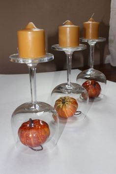 Upcycle recycle wine glass. Need a super quick centerpiece? Grab three wine glasses, three small candles and three small fall decorations. Click through to see different centerpieces.  A simple DIY fall decor addition to a tabletop.