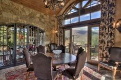 Dining Room with intricate rock wall above the custom