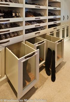 Boot drawers and pull-out shoe shelves.  Keeps dust off of boots.