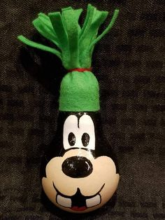 Goofy painted onto lightbulb to create a fun new ornament
