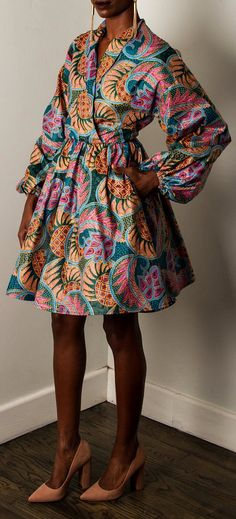 NEW The Joan Dress. Shawl Collar Elastic Waist Full Flare Skirt 100% Cotton Dress. Bishop Dolman sleeves. Front snap closures. Full flare skirt w/ pockets. Pull over dress. Ankara | Dutch wax | Kente | Kitenge | Dashiki | African print dress | African fashion | Ankara maxi skirt | African prints | Nigerian style | Ghanaian fashion | Senegal fashion | Kenya fashion | Nigerian fashion | Ankara styles | Ankara dress (affiliate)