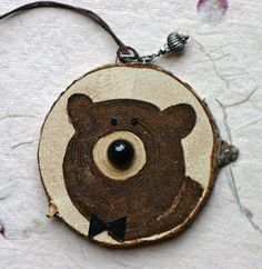 Christmas ornament, wood slice ornament, brown fuzzy bear face, childrens art, round, nursery art, black and brown, bear and bow tie