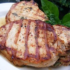 Pork chops are flavored with a sweet and savory barbeque sauce- and apple butter-based marinade that caramelizes over the chops as they grill.