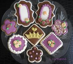 Vintage inspired sugar cookies.  Brown, ivory, gold and fuchsia.  Crowns, flowers, marbling, roses, plaques, fleur de lis, and more. ~Leslie