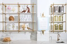 Brass hanging open shelving unit with stone shelves Glass Shelving Unit, Brass Shelving, Open Shelving Units, Glass Wall Shelves, Floating Glass Shelves, Gold Shelves, Glass Shelves Kitchen, Bar Shelves, Retail Shelving