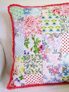 pretty patchwork cushion with a crochet trim love the crochet trim.