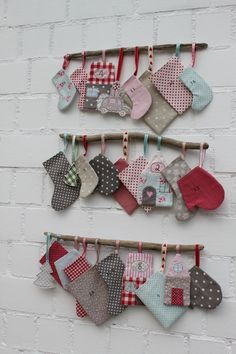 I like the idea of using sticks to hang the advent pockets. Study and easy