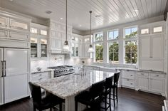 by Borges Brooks BuildersSanta Rosa Beach Florida, FL, US 32459 ·  7 photosadded by lisamarie63		White Kitchen  					http://borgesbrooksbuilders.com  			Traditional kitchen meets eclectic