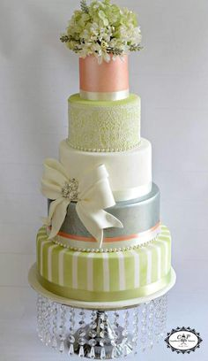 Seafoam green cake with light coral and white. Very pretty combination.
