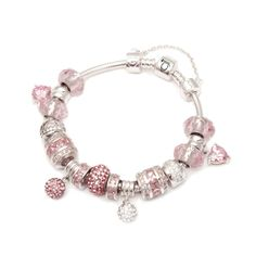 The Pink Caprice Crystal Silver Charm Bracelet Signature Collectionis a delicate feminine silver charm bracelet that boasts the beautiful combination of pink and silver. It is a gorgeous piece of jewelry that alludes a modern and sharp look reminiscent of a pink caprice. The Pink Caprice Crystal Silver Charm Bracelet Signature Collection