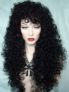 Sensuous, full, curly and long black drag queen wig